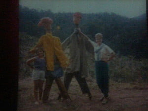 Extremely poor quality pic of my sister and myself (left) proudly displaying our handmade scarecrows. If only they had a brain!